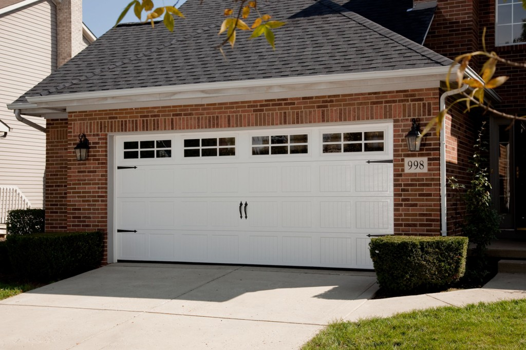 Carriage style garage doors carroll garage doors for Two door garage