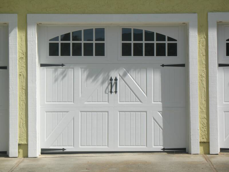 Carriage style garage doors carroll garage doors for Carriage style garage doors with windows