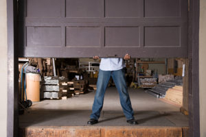 If the power goes out, should I open my garage door manually?