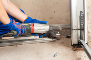 What Are the Signs That It Is Time to Call a Garage Door Repair Pro?
